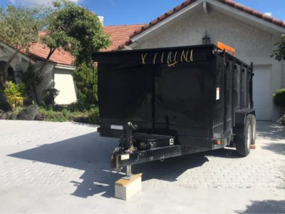 Dumpster trailer sitting in a driveway